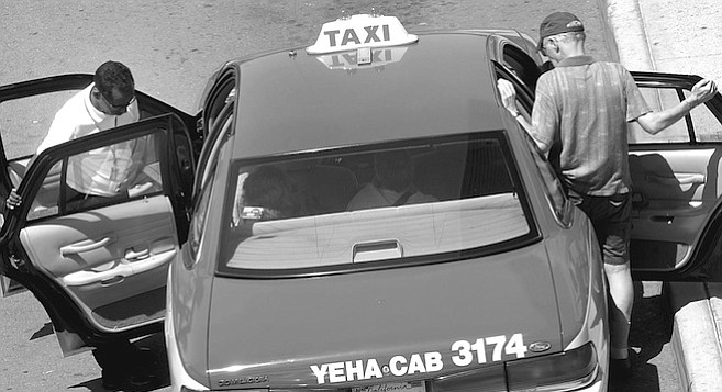 """Taxi at airport. One Afghani makes almost no money at all but keeps his job so that his family has a car to use. An Iranian man told me he does well enough, although he loses """"about a fare a week"""" to runaway fare-jumpers.  - Image by Joe Klein"""