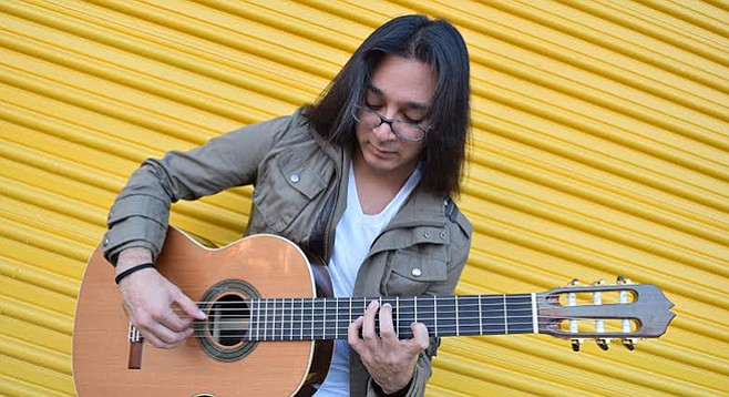 Though he looks heavy metal, the polished and shaped nails on Kevin Hernandez' fingers out him as a classical guitarist.