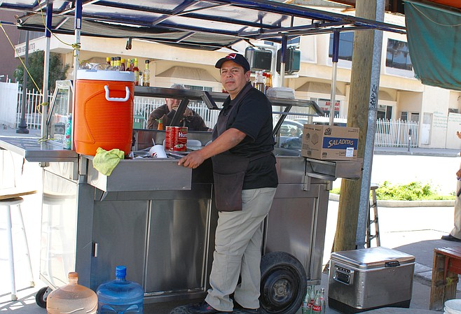 Israel Carrillo at his seafood stand