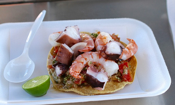 Fish, shrimp, and octopus ceviche tostada
