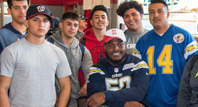 """Denzel Perryman (center) flew in from Miami, went to Sweetwater High, and said, """"it was so important for the Chargers to build this facility for these students."""""""