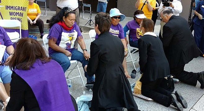 The march concluded outside city hall with a rally and clergy washing the feet of janitorial staff.