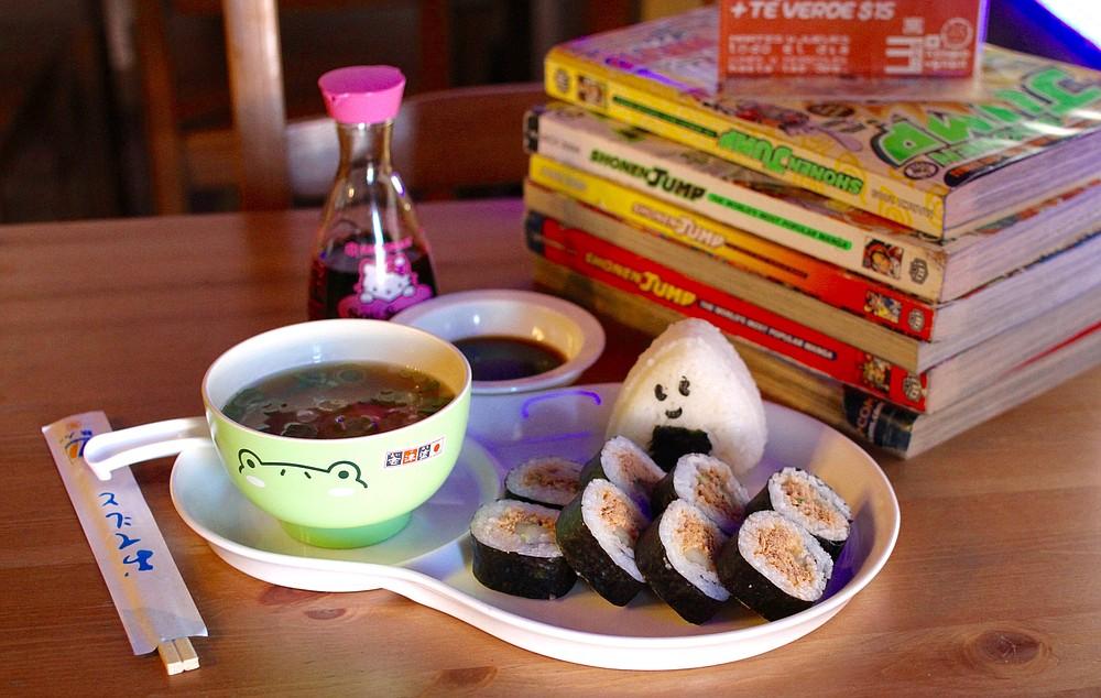 Miso soup, onigiri, and spicy tuna mako sushi
