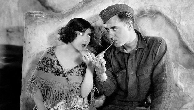 Renée Adorée and John Gilbert find love before the ruins in King Vidor's The Big Parade.