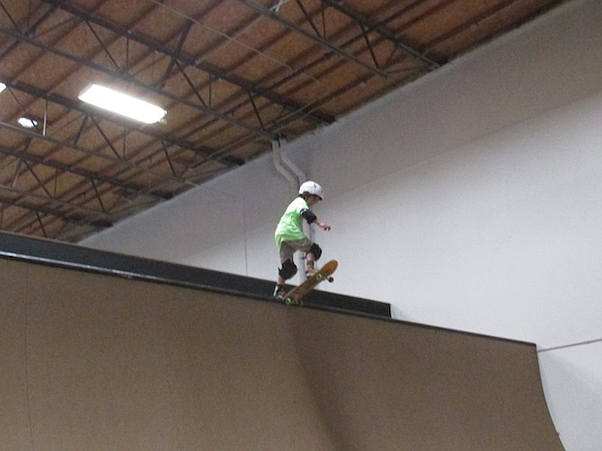 A young skater gets ready to drop in on the new 11.5-foot half-pipe
