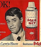 Hold back the grease with Aqua-Net, funnyman Jerry Lewis's favorite aerosol hair bond. 1963.