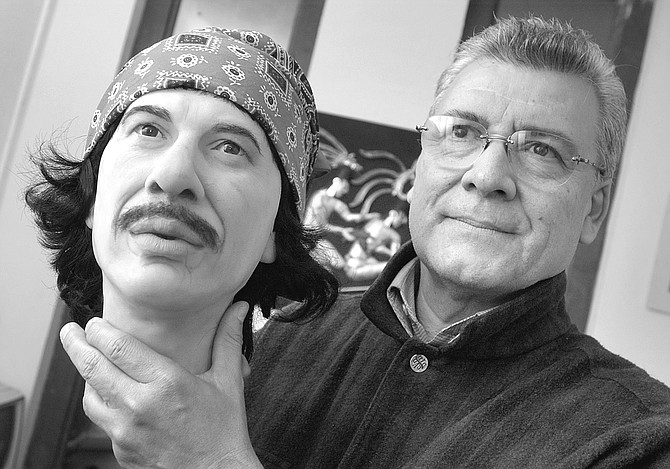 "Ricardo Parra Montes holding Carlos Santana wax head.  ""He's going to go over there, by the Ayatollah Khomeini."" - Image by Joe Klein"