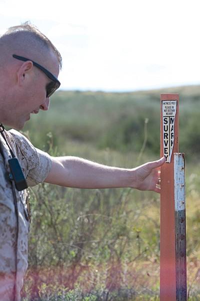 Capt. Chris Robinson points out a survey marker