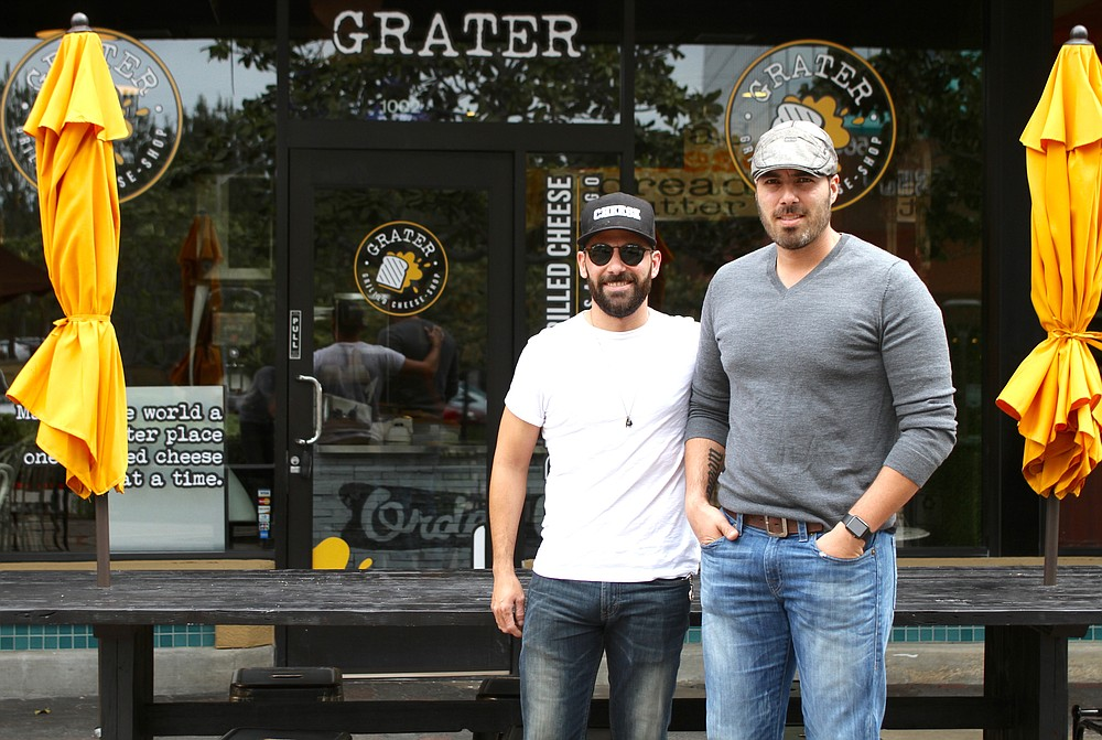 The Corbalá brothers in front of their newest location