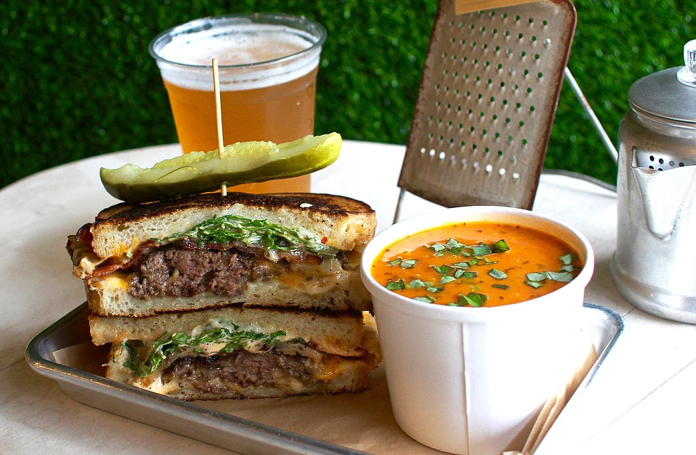 The Carnivore Sandwich with several add-ons and a full tomato soup
