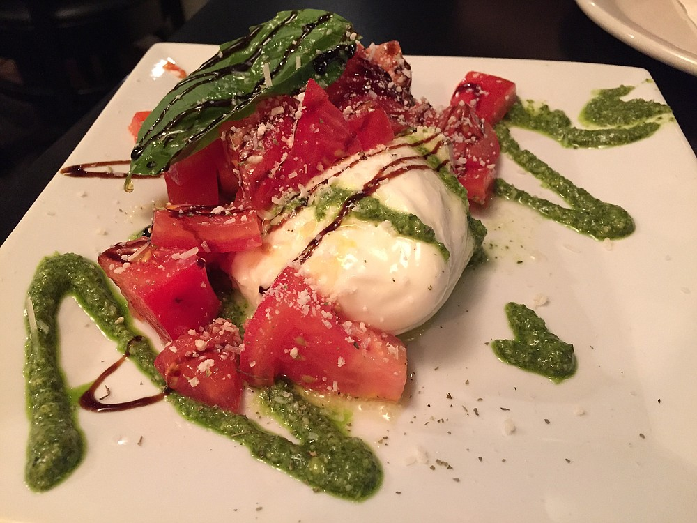 An exceptionally flavorful burrata mozzarella salad