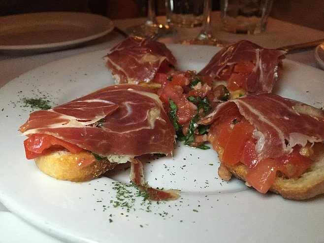 More like Italy's bruschetta than Spain's pan con tomate, though still delicious