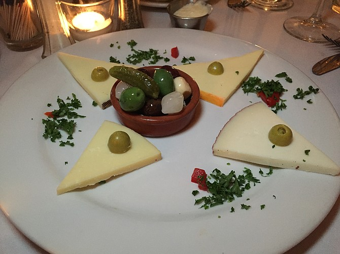 The selection of Spanish cheeses, with some salty garnishes