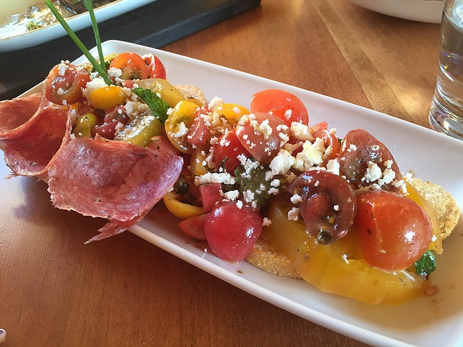 Tomato salad with feta, capers, watermelon, and soppressata