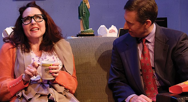 Maureen (Brenda Adelman) among the skeletal remains of her takeout binge, with brother-in-law, Squire (NIck Charles), for company. - Image by Ken Jacques