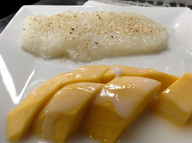 Mango in coconut milk, sticky rice with sesame seeds