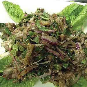 Larb, Laos' beautiful mess of duck, salad, veggies, and spices