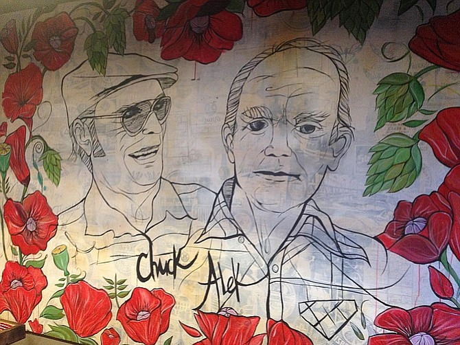 A mural depicts the owners' respective grandfathers, Chuck and Alek