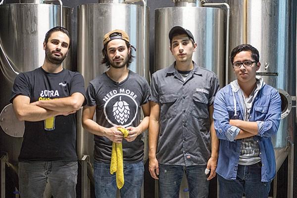 Adrian Echavarria with his brother Luis and partners Elio Avendaño and Javier Alvarado inside Baja Brew Labs