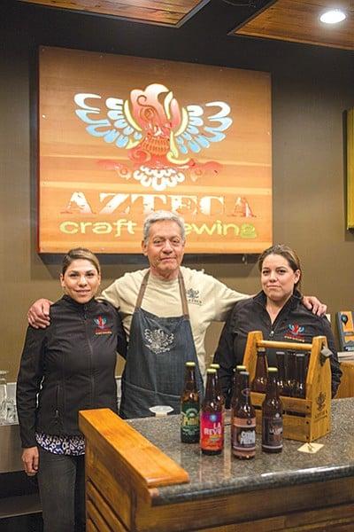 Joel López with his daughters Ximena and Karla inside Azteca Craft