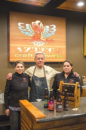 Joel López with his daughters Ximena and Karla inside Azteca Craft