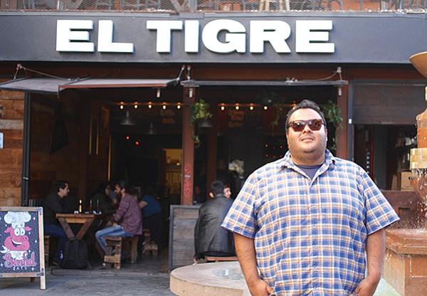 Juan Carlos Bucio in front of El Tigre Bar