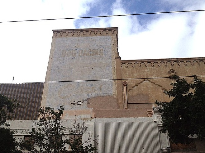 """The dog-racing sign on the south façade was painted in the 1960s/1970s. """"It's pretty faded but can be restored. The patina is part of the history,"""" said Coons."""