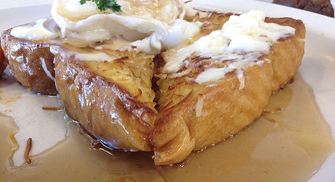 Coconut french toast, with slatherings of butter and a poached egg