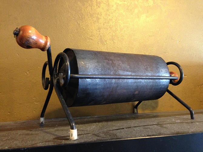 An antique campfire coffee roaster once used by the Pavaraga family to cook beans on the beaches of Hawaii.