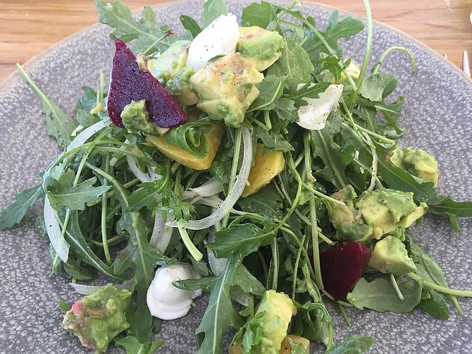 Rocket Salad has beets, arugula, Maui onion, and a balsamic vinaigrette