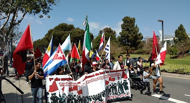 Marchers headed south from City College to Chicano Park