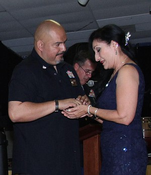 Commander Miguel Alatorre presented to Sara Sandoval a medal for her deceased husband, Raul Sandoval.