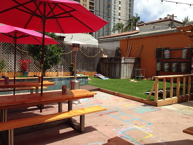 The dog-friendly patio at has room for dozens to eat, drink, and play cornhole.
