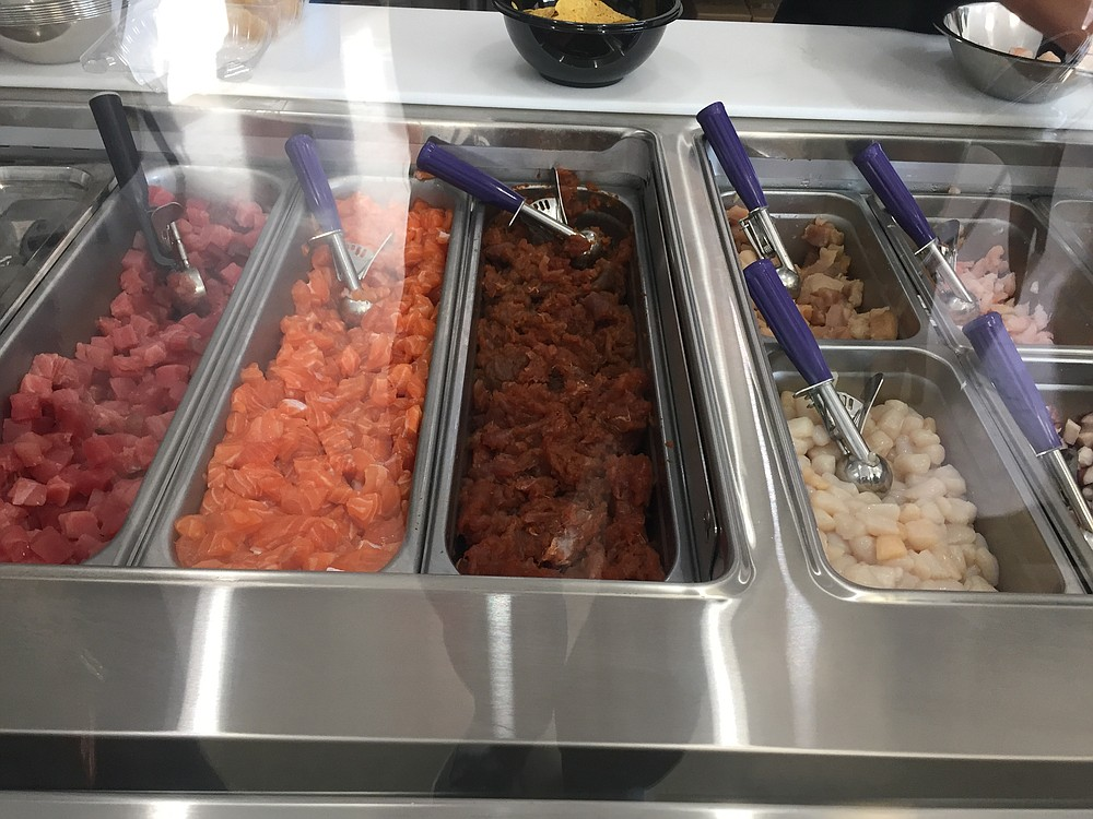 Pick your choice of raw fish, including tuna, shrimp, spicy tuna, scallops, and octopus