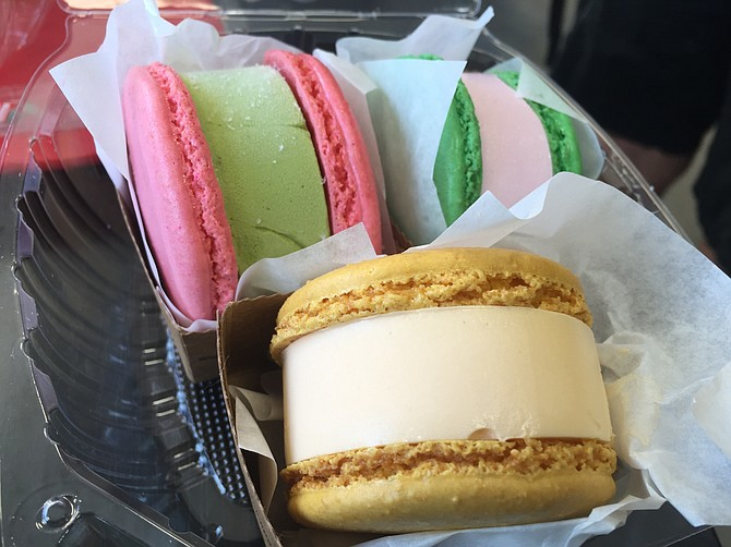 There are a variety of macaron ice cream sandwiches.