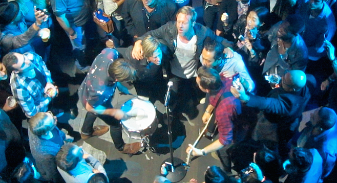 "A kumbaya moment — the band formed a semi-circle in the audience and played an acoustic rendition of 2009's Grammy Award–winning ""Hello Hurricane."""