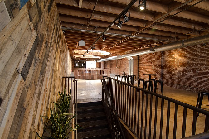 Mission Brewery's newly opened events space and tasting room expansion features exposed brick, reclaimed wood and large round skylights where grain silos used to stand taller than the rooftop.