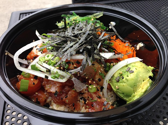 Three kinds of fish, two kinds of seaweed, masago roe, and a scoop of avocado