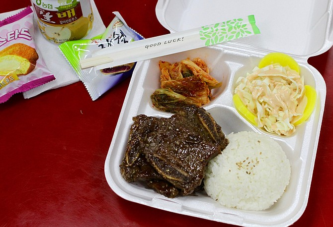 Galbi beef ribs, white sticky rice, salad with danmuji, and a side of kimchi