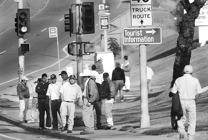 Corner of I-5 off-ramp and Encinitas Boulevard. When it comes to patience, these guys are like monks compared to most Americans. - Image by Sandy Huffaker, Jr.