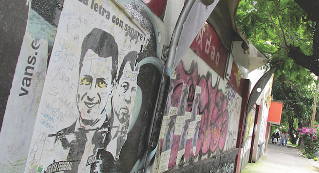 Graffiti art covers a wall in the pedestrian-friendly Coyoacán neighborhood.