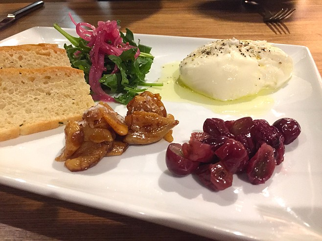 Burrata with sweet garlic and pickled grapes