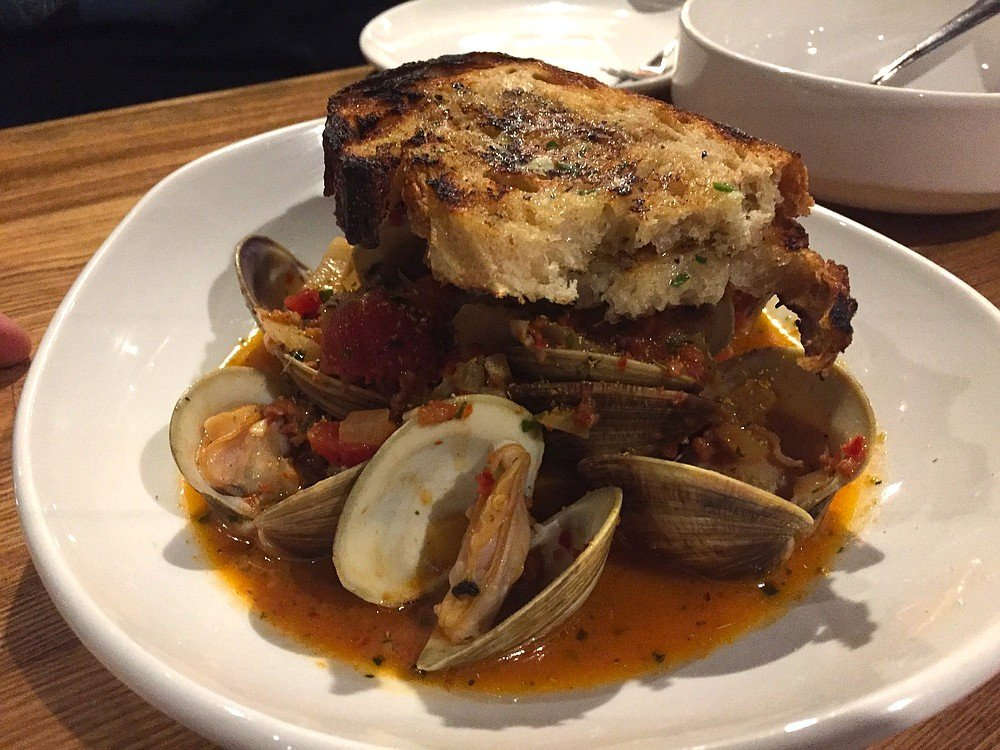 Steamed clams with spicy salami