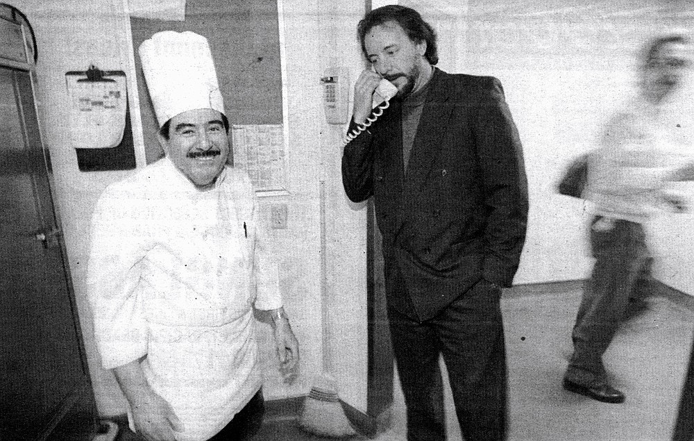 "Chef William Rivera (left) and Jef Eatchel (center) on phone.  ""For a lot of these people, this is their main meal, and it's usually two: one before or after your shift, one on your break."""