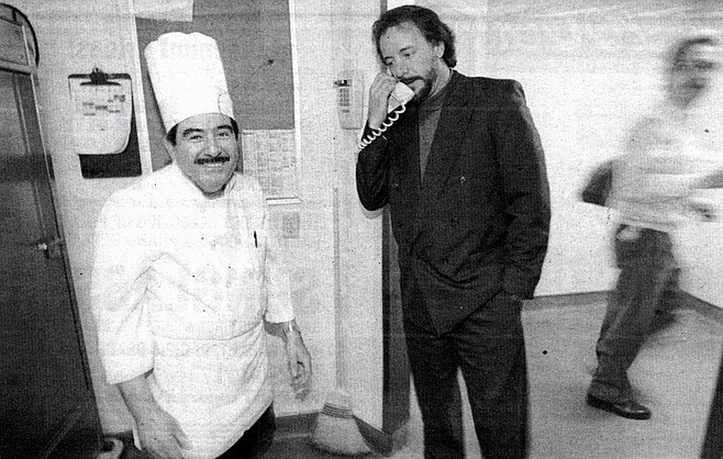 """Chef William Rivera (left) and Jef Eatchel (center) on phone.  """"For a lot of these people, this is their main meal, and it's usually two: one before or after your shift, one on your break."""""""