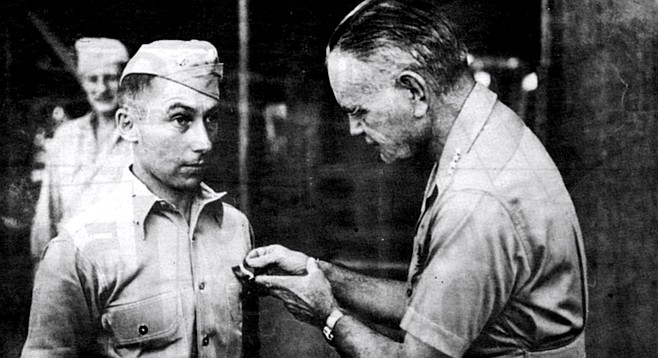 Admiral William Halsey awarding Navy Cross to Victor Krulak, Soloman Islands, 1943. Krulak had been ordered by Halsey to conduct night-time amphibious raids.