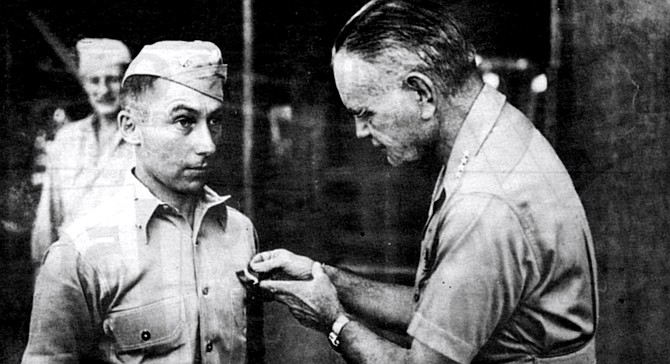 Admiral William Halsey awarding Navy Cross to Victor Krulak, Soloman Islands, 1943. Krulak had been ordered by Halsey to conduct night-time amphibious raids. - Image by Craig Carlson