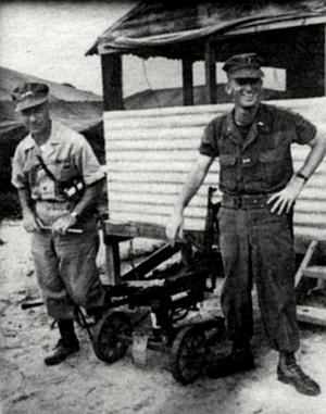 """Krulak and son near Danang, South Vietnam, 1965. """"One son was wounded twice, one tripped a booby trap and it went off and it was a dud, and he might have been killed. The other— the eldest, a chaplain — was very lucky. He spent an awful lot of time in the front lines and came out unscathed."""""""