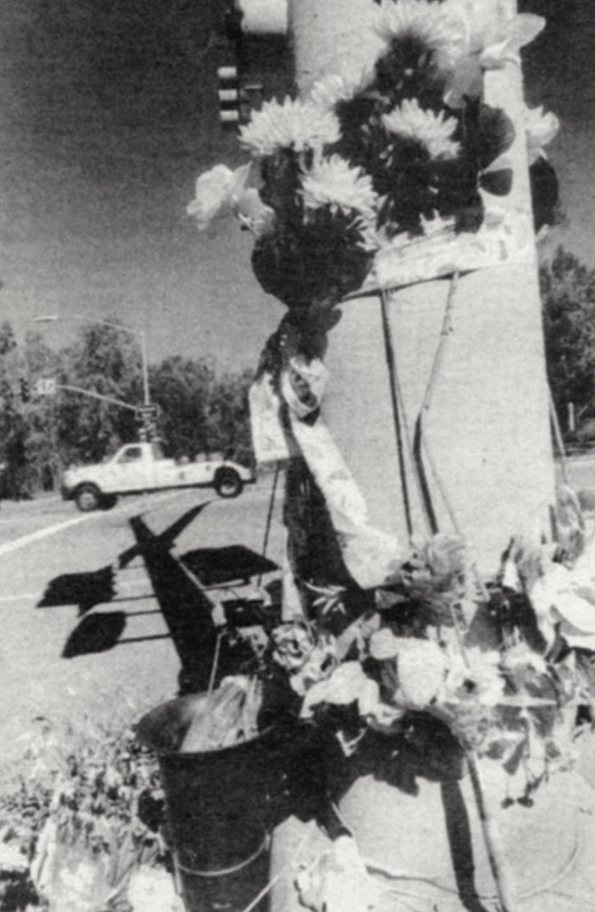 Noelle Marra memorial, Pomerado Road and Avenida Magnifica, Scripps Ranch. Noelle's parents were watching Masterpiece Theatre on TV when someone came screaming that there had been a horrible accident. Police wouldn't allow Chris Marra to approach the car.