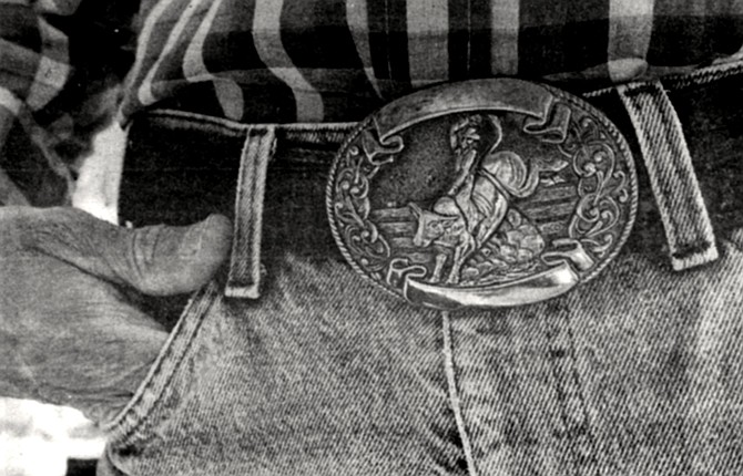 Massey's wear-faded jeans were cinched with a belt into whose bronze buckle had been cast a cowboy riding a brahma bull.